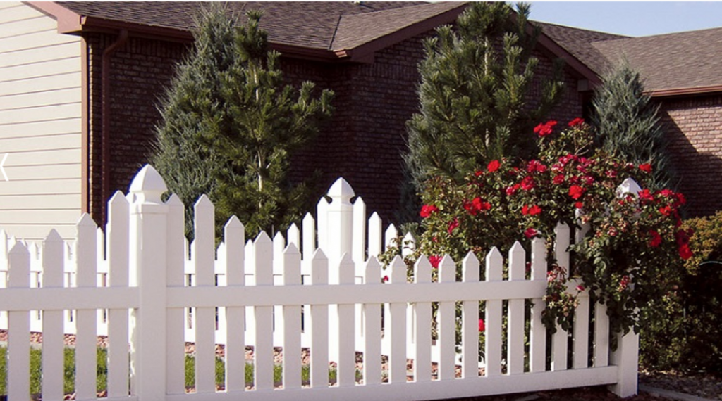 Kane installed a beautiful white vinyl fence from Duramax and her yard looks amazing